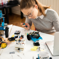 Engineering Your Future Today - Girl Putting Together Robot