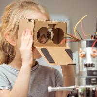 Engineering Your Future Today - Girl Peering Through Cardboard Binoculars